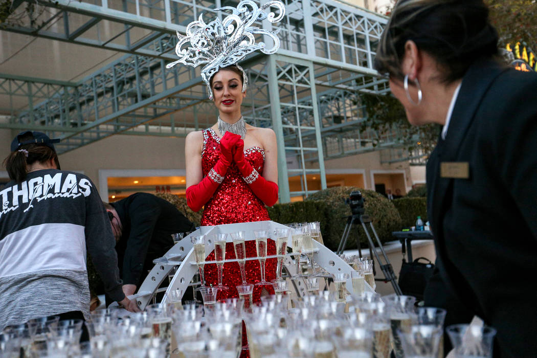 Alexandra Remke stands in a champagne dress structure at the Paris Las Vegas as it debuts a new $1.7 million Eiffel Tower light show on the Strip in Las Vegas, Wednesday, Feb. 27, 2019. (Caroline ...