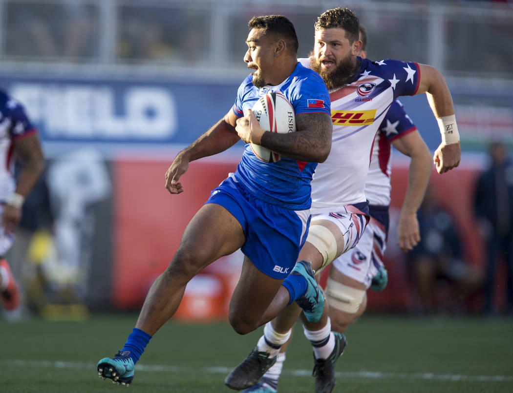 Martin Iosefo of Samoa breaks away from Danny Barrett of the US during day one of the USA Sevens Rugby tournament at Sam Boyd Stadium in Las Vegas on Friday, March 2, 2018. Richard Brian Las Vegas ...