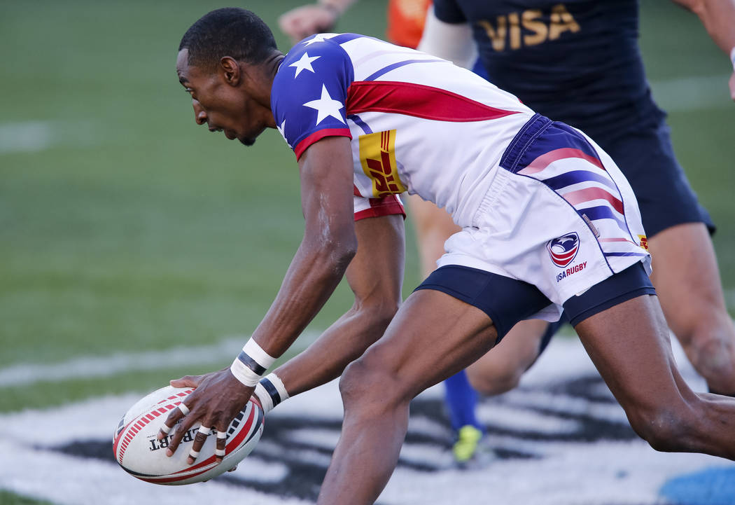 Perry Baker of the United States scores a try against Argentina during the HSBC USA Sevens rugby tournament Cup Final's in Las Vegas on Sunday, March 4, 2018. Richard Brian Las Vegas Review-Journa ...