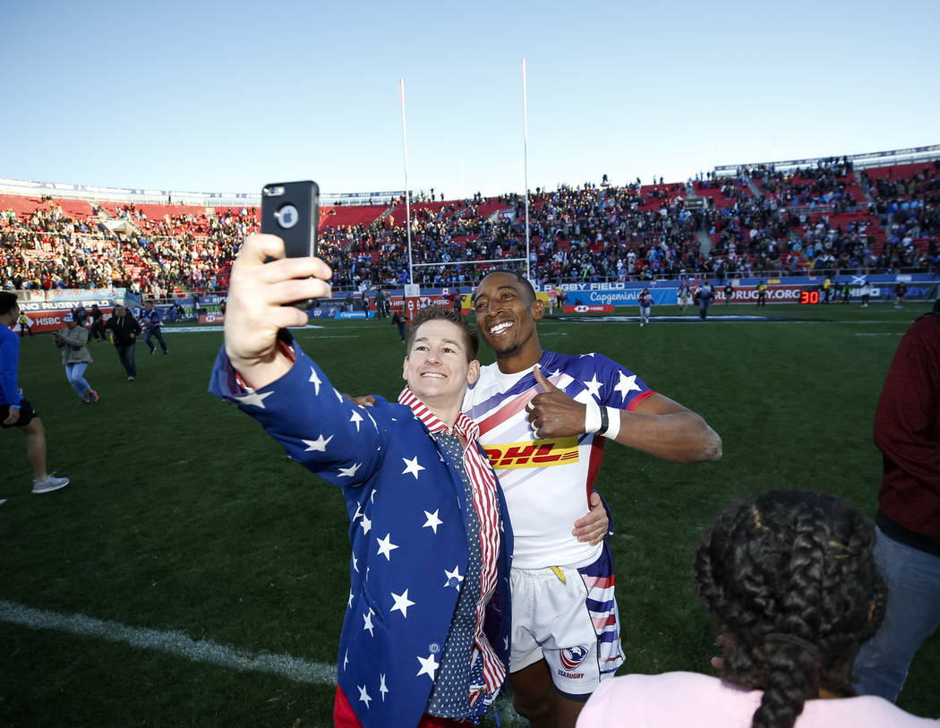 Perry Baker of the United States celebrates with fans after defeating Argentina 28 - 0 in the HSBC USA Sevens rugby tournament Cup Final's in Las Vegas on Sunday, March 4, 2018. Richard Brian Las ...