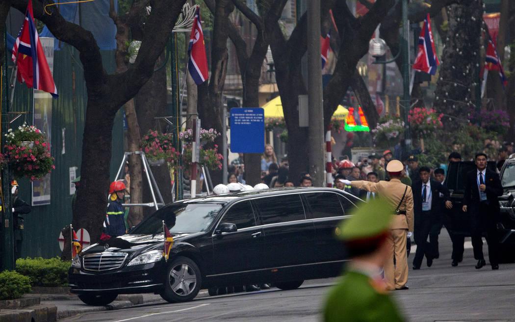 Bodyguards run behind the motorcade of North Korean leader Kim Jong Un as he returns to the Melia Hotel, Thursday, Feb. 28, 2019, in Hanoi. (Gemunu Amarasinghe/AP)