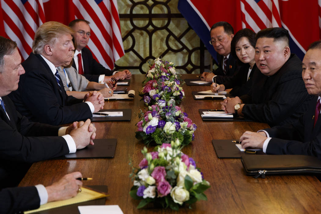 President Donald Trump speaks during a meeting with North Korean leader Kim Jong Un Thursday, Feb. 28, 2019, in Hanoi. At front right is Kim Yong Chol, a North Korean senior ruling party official ...