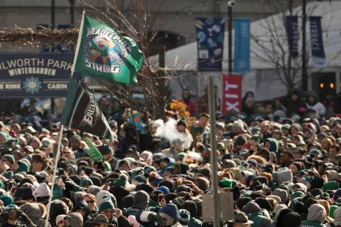 Philadelphia Eagles' fans wait to celebrate during a Super Bowl victory parade, Thursday, Feb. 8, 2018, in Philadelphia. The Eagles beat the New England Patriots 41-33 in Super Bowl 52. (AP Photo/ ...