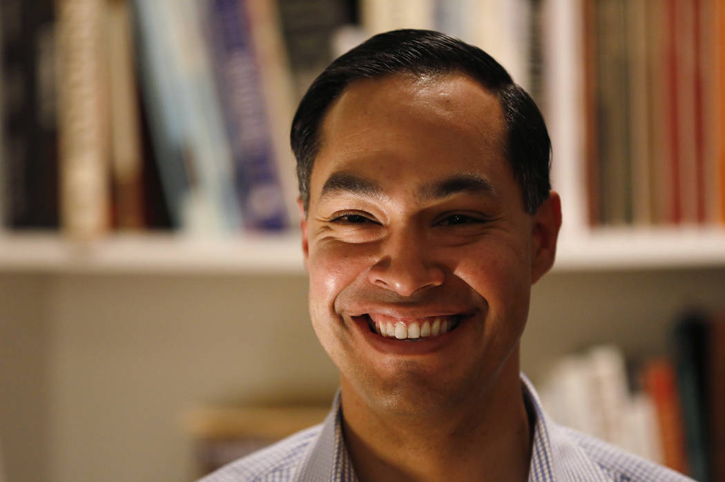 Former Housing and Urban Development Secretary Julian Castro speaks during a house party at the Ed and Jane Cranston home, Monday, Jan. 7, 2019, in North Liberty, Iowa. (AP Photo/Charlie Neibergall)