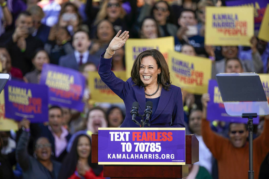 Democratic Sen. Kamala Harris, of California, waves to the crowd as she formally launches her presidential campaign at a rally in her hometown of Oakland, Calif., Sunday, Jan. 27, 2019. (Tony Avel ...