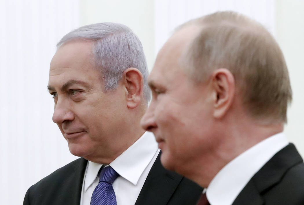 Russian President Vladimir Putin, right, and Israeli Prime Minister Benjamin Netanyahu pose for a photo during their meeting in the Kremlin in Moscow, Russia, Monday, May 27, 2013. (Maxim Shemetov ...