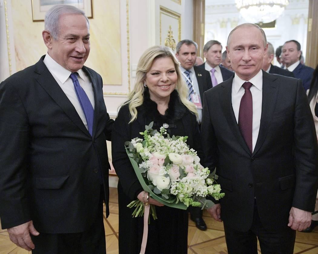Russian President Vladimir Putin, right, Israeli Prime Minister Benjamin Netanyahu, and his wife, Sara, pose for a photo after talks in the Kremlin in Moscow, Russia, Wednesday, Feb. 27, 2019. Isr ...