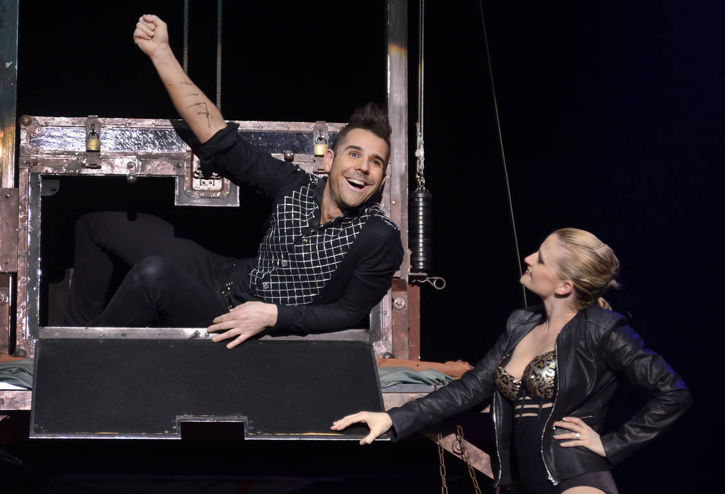 "Jan Rouven, left, performs with cast member Sarah Vose during ""The New Illusions"" at the Tropicana Las Vegas on the Strip on March 11, 2015. (Bill Hughes/Las Vegas Review-Journal)"