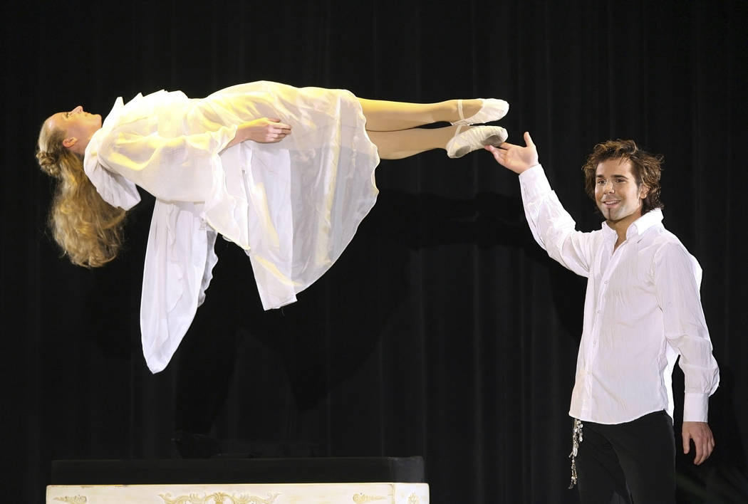 FILE - In this March 17, 2007, file photo, magician Jan Rouven Fuechtener presents the Floating Virgin during the dress rehearsal of a German TV show in Riesa, eastern Germany. Fuechtener, a forme ...