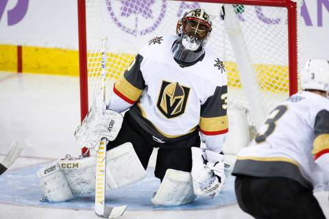 Vegas Golden Knights goalie Malcolm Subban, left, reacts after letting in a goal during second period NHL hockey action against the Calgary Flames in Calgary, Alberta, Monday, Nov. 19, 2018. (Jeff ...