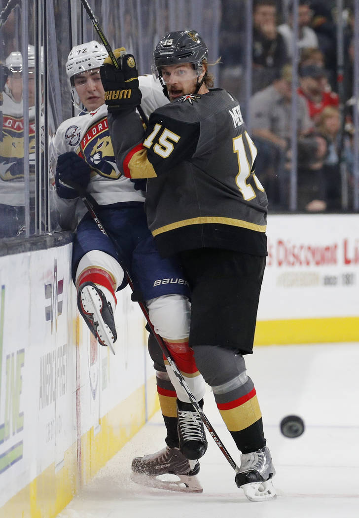 Vegas Golden Knights defenseman Jon Merrill (15) checks Florida Panthers center Frank Vatrano into the boards during the first period of an NHL hockey game Thursday, Feb. 28, 2019, in Las Vegas. ( ...
