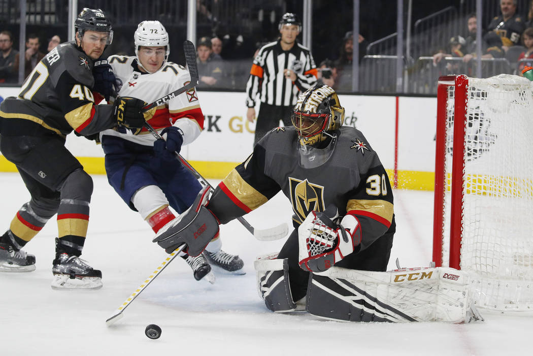 Vegas Golden Knights goaltender Malcolm Subban (30) blocks a shot by the Florida Panthers during the first period of an NHL hockey game Thursday, Feb. 28, 2019, in Las Vegas. (AP Photo/John Locher)
