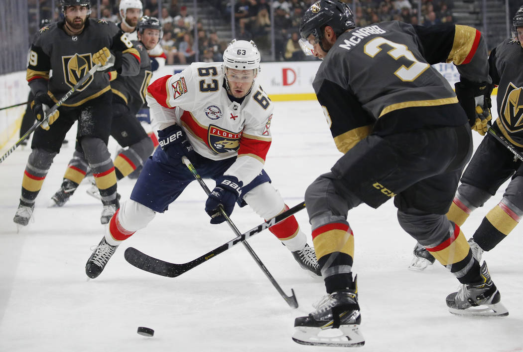 Florida Panthers right wing Evgenii Dadonov (63) competes for the puck with Vegas Golden Knights defenseman Brayden McNabb (3) during the first period of an NHL hockey game Thursday, Feb. 28, 2019 ...