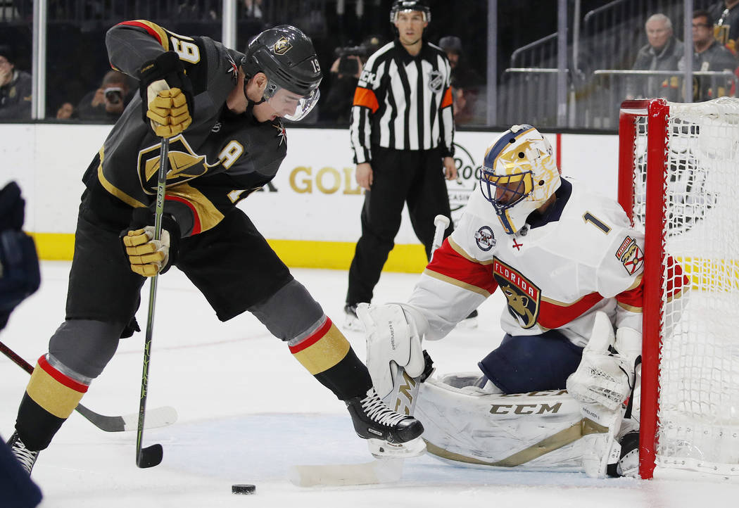 Vegas Golden Knights right wing Reilly Smith (19) scores on Florida Panthers goaltender Roberto Luongo (1) during the second period of an NHL hockey game Thursday, Feb. 28, 2019, in Las Vegas. (AP ...