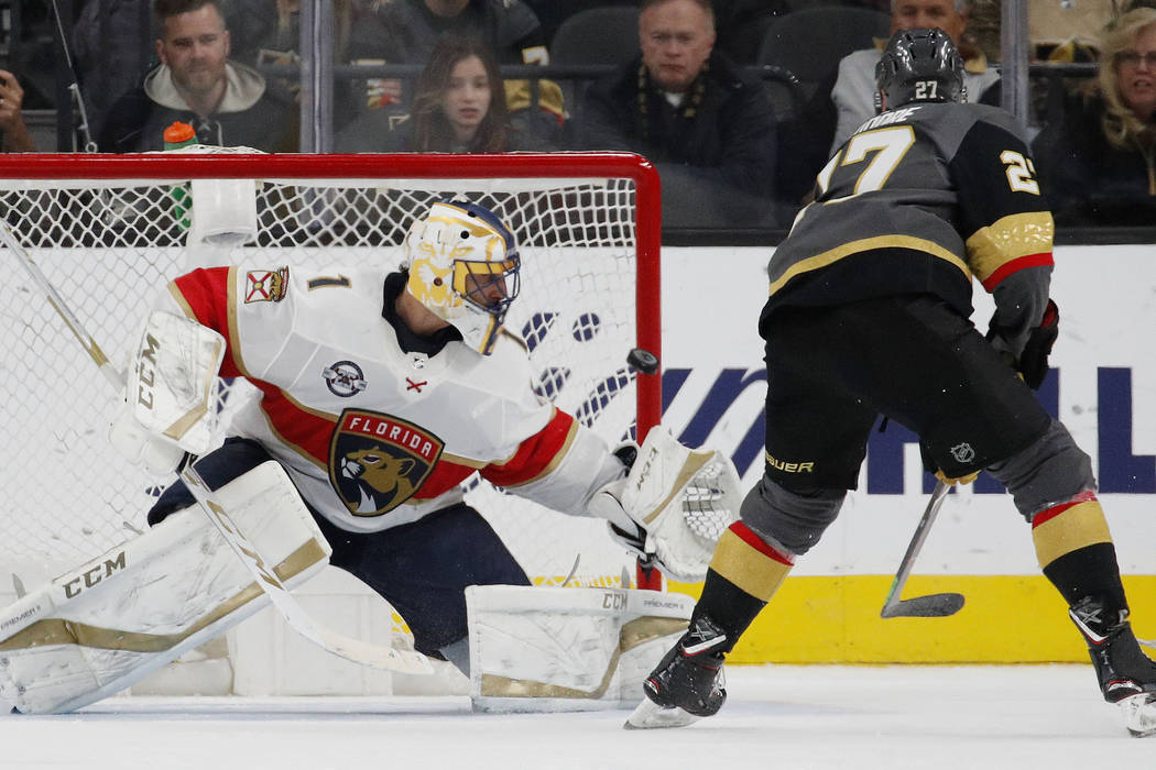 Vegas Golden Knights defenseman Shea Theodore (27) scores on Florida Panthers goaltender Roberto Luongo (1) during the shootout in an NHL hockey game Thursday, Feb. 28, 2019, in Las Vegas. (AP Pho ...