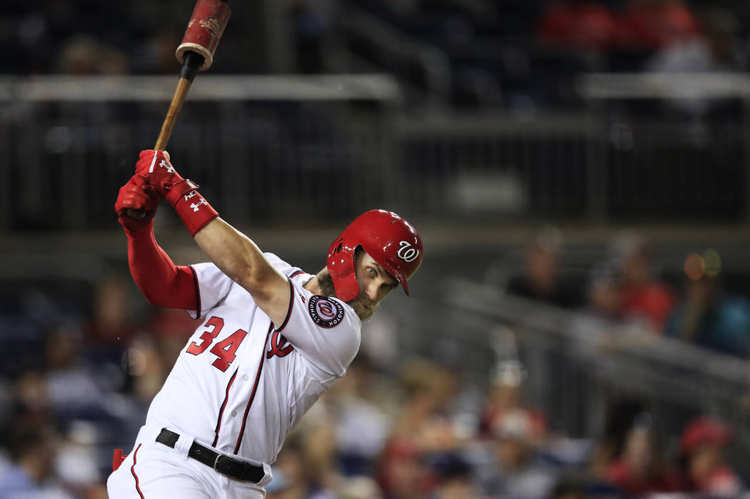 Washington Nationals Bryce Harper practices his swing during the seventh inning of a baseball game against the Miami Marlins in Washington, Wednesday, Sept. 26, 2018. (AP Photo/Manuel Balce Ceneta)