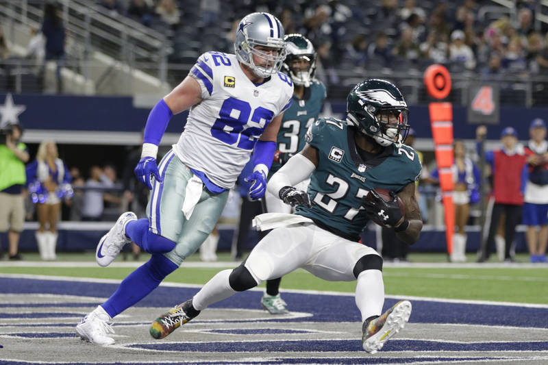 Philadelphia Eagles safety Malcolm Jenkins (27) slides after making an interception in the fourth quarter as Dallas Cowboys tight end Jason Witten (82) defends at AT&T Stadium, Arlington, Texas, N ...