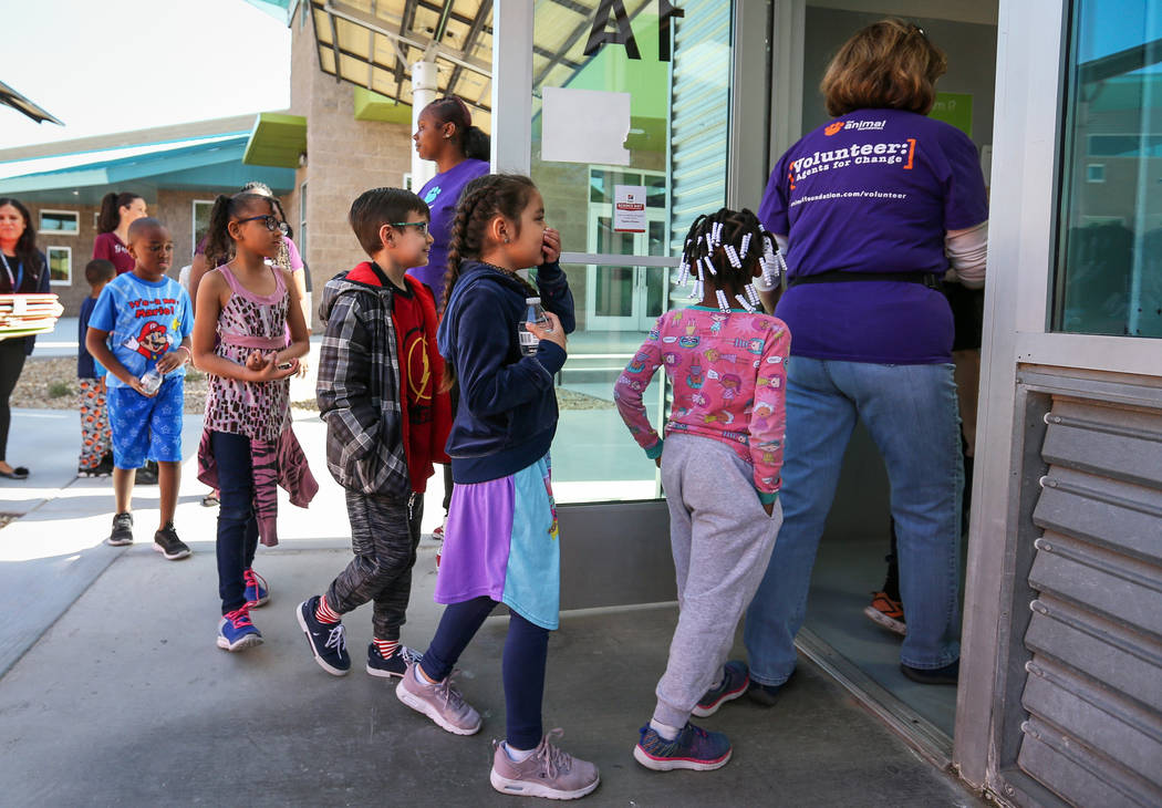 CCSD first graders line up to outside where the dogs are kept as participate in the 4th Annual ÔReading to Dogs in KennelsÕ event at The Animal Foundation during Nevada Reading Week in L ...