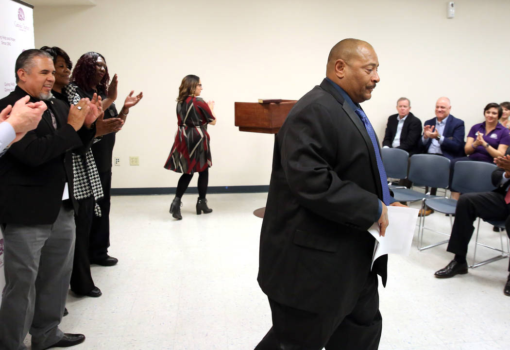 Attendees applaud after John Bontemps received his certificate during the Renewing HOPE graduation for homeless who spend nine months in Catholic Charities program on Thursday, Feb. 28, 2019, in L ...