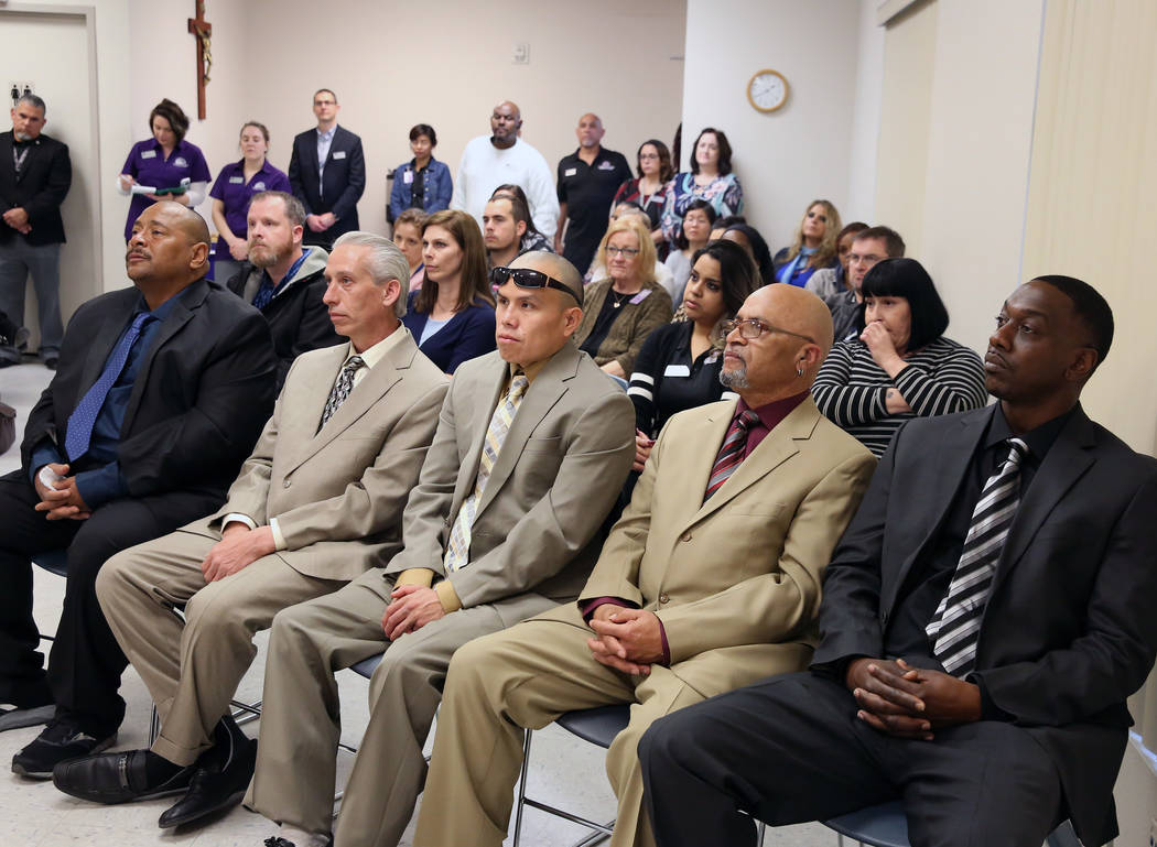 Graduates Broderick Gray, right, Theodore Hines, Derrick Johnson, center, Ricky Delucia, and John Bontemps attend the Renewing HOPE graduation for homeless who spend nine months in Catholic Charit ...