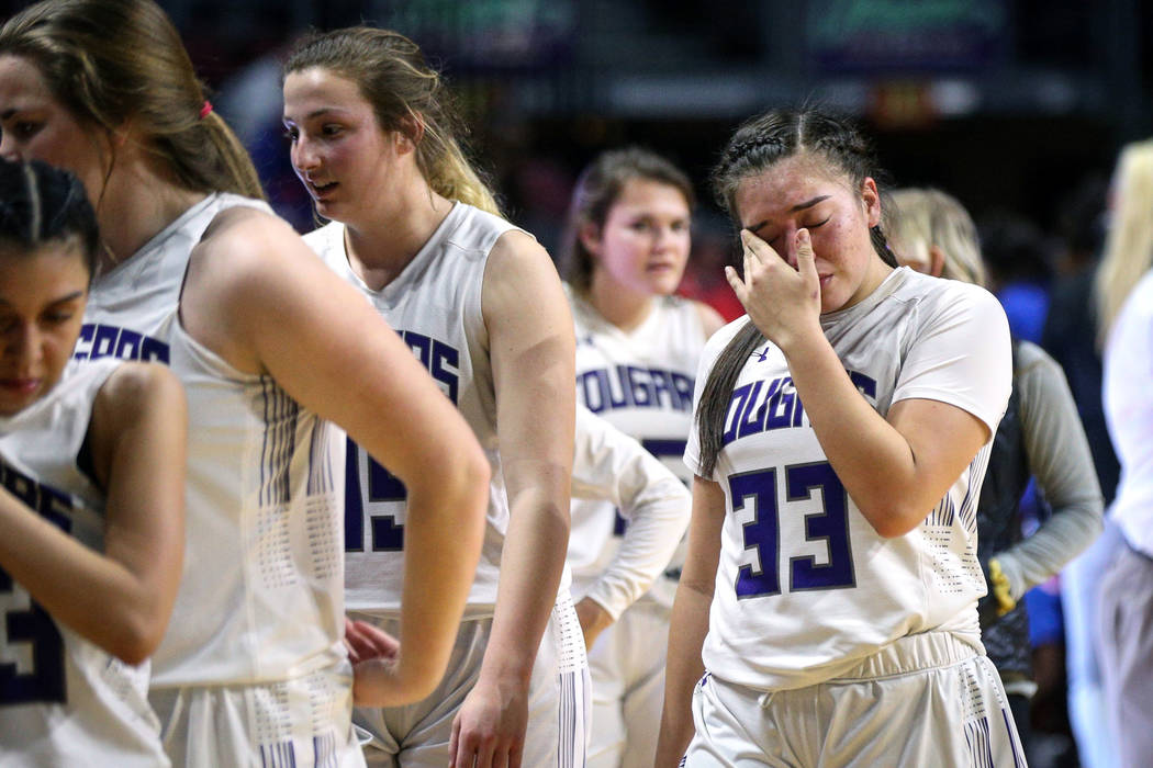 Spanish Springs' Mariah Barraza (33) wipes away tears after losing to Bishop Gorman during a Class 4A state girls basketball semifinal game at the Orleans Arena in Las Vegas, Thursday, Feb. 28, 20 ...