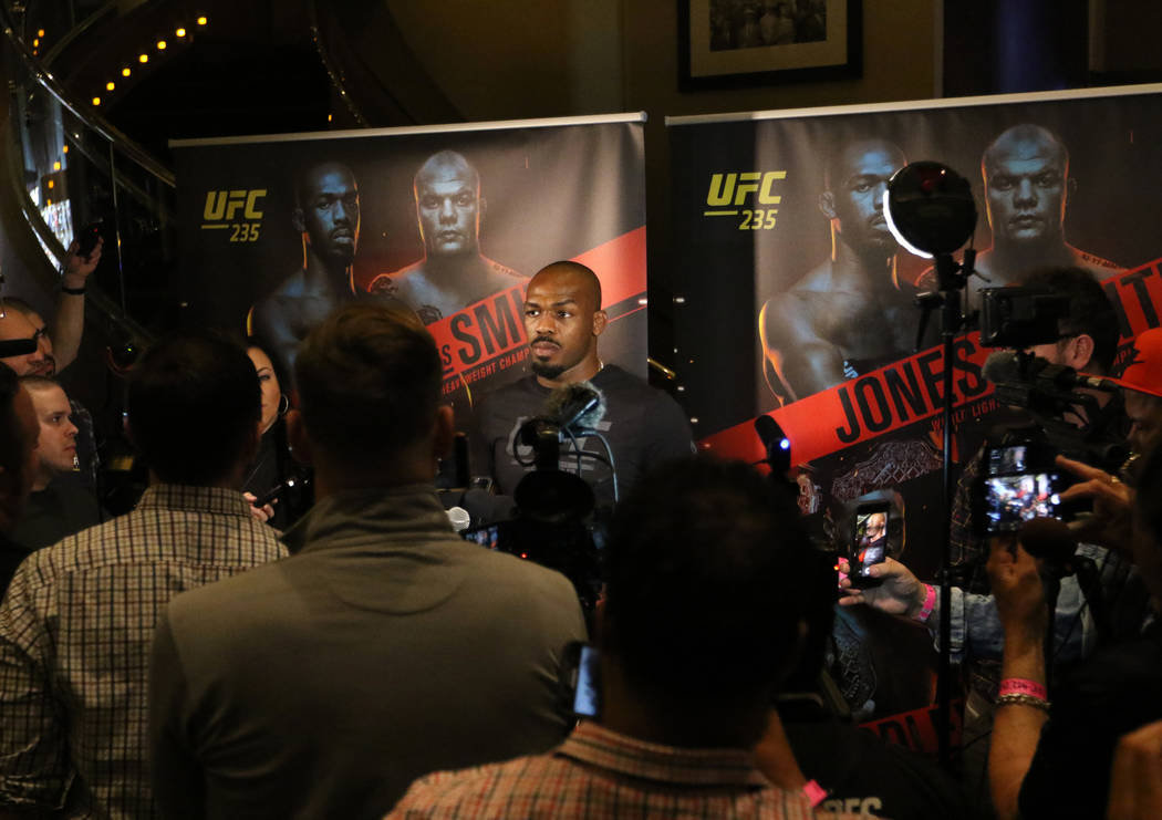 UFC light heavyweight champion Jon Jones listens to questions during a media scrum at UFC 235 open workouts at the MGM Grand hotel-casino in Las Vegas, Thursday, Feb. 28, 2019. (Heidi Fang /Las Ve ...