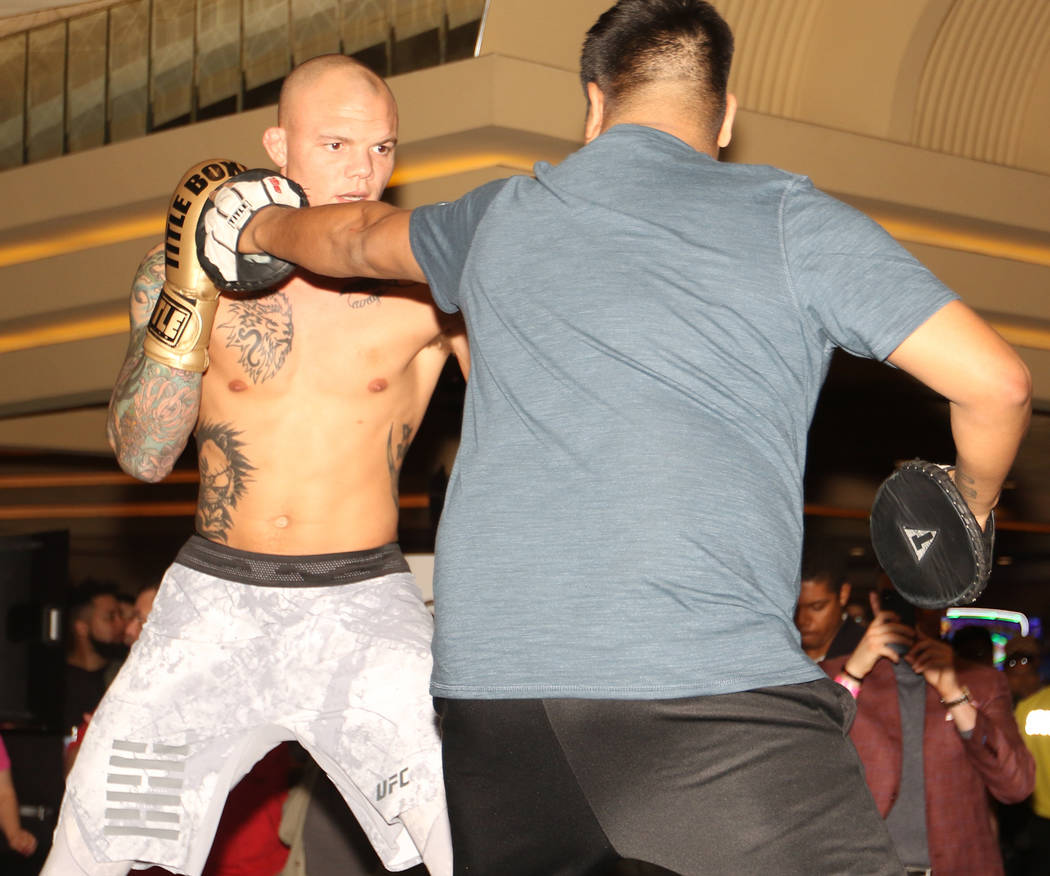 UFC light heavyweight Anthony Smith hits mitts with his coach Danny Molina, right, at UFC 235 open workouts at the MGM Grand hotel-casino in Las Vegas, Thursday, Feb. 28, 2019. (Heidi Fang /Las Ve ...
