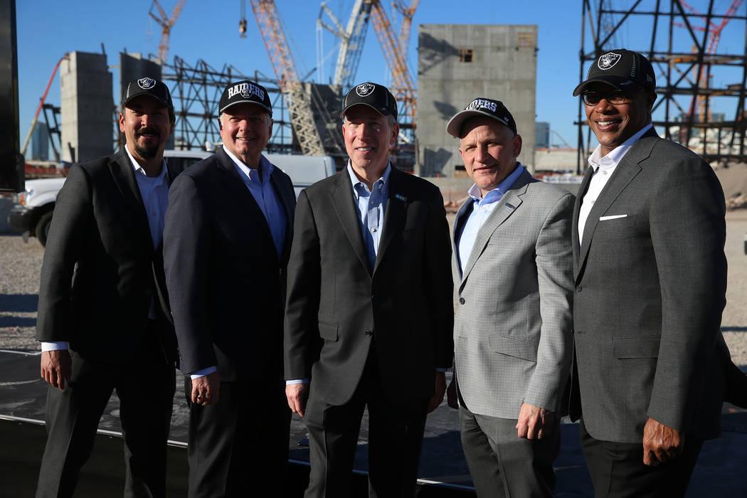 Mark Shearer, from left, Raiders senior vice president, Mike Bolognini, market vice president for Cox Communications Las Vegas, Pat Esser, president of Cox Communications, Marc Badain, president o ...
