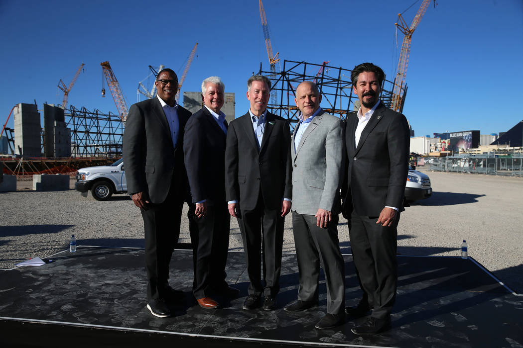Derrick Hill, from left, vice president for Cox Business, Mike Bolognini, market vice president for Cox Communications Las Vegas, Pat Esser, president of Cox Communications, Raiders president Marc ...