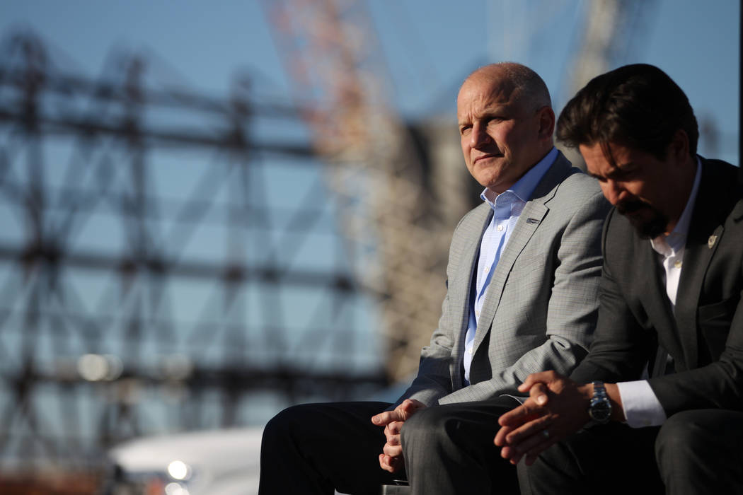 Marc Badain, left, president for the Raiders, and Mark Shearer, senior vice president for the Raiders, participate during a press conference at the Raiders stadium construction site in Las Vegas, ...