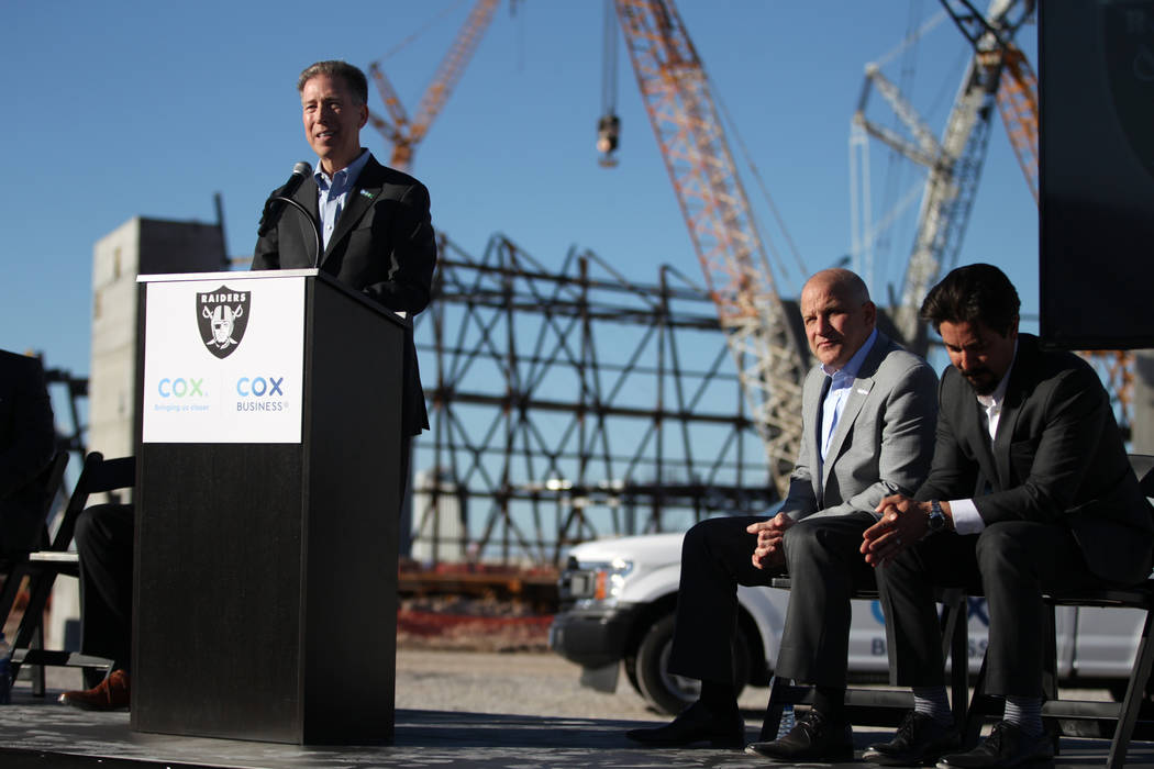 Pat Esser, from left, president of Cox Communications, with Marc Badain, president for the Raiders, and Mark Shearer, senior vice president for the Raiders, speaks during a press conference at the ...