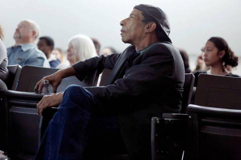 "Local filmmaker Stan Armstrong who graduated in 1972 from Rancho High School, watches his documentary film, "" The Rancho High School Riots,"" with students and guests at Rancho High Sch ..."