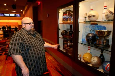 Red Rock Lanes Bowling Operations Manager Dennis Mathews shows the trophy case featuring major ...