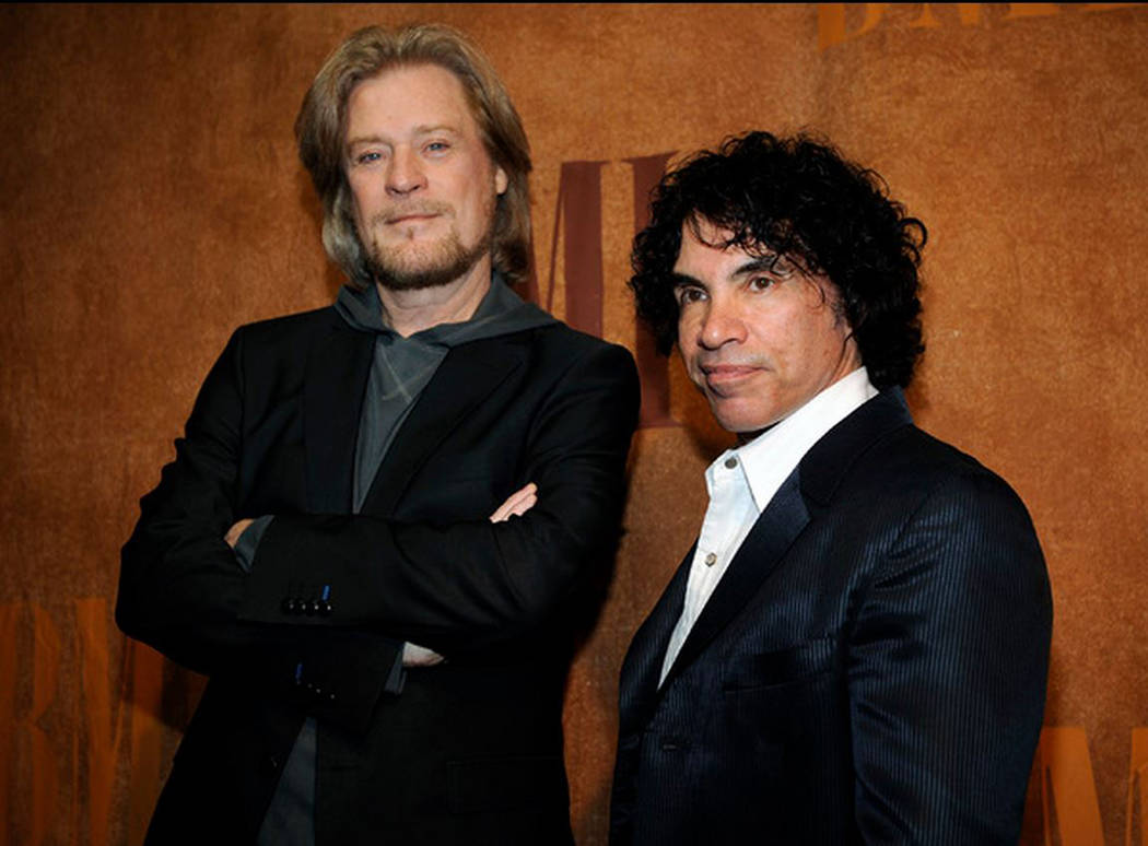 Daryl Hall, left, and John Oates pose together before the 56th annual BMI Pop Awards in Beverly Hills, Calif. on May 20, 2008. (AP Photo/Chris Pizzello, file)