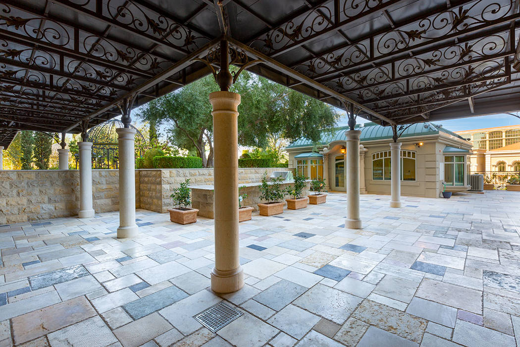 Ivan Sher Group The garden home features a 4,000-square-foot courtyard, outdoor kitchen and 1,0 ...