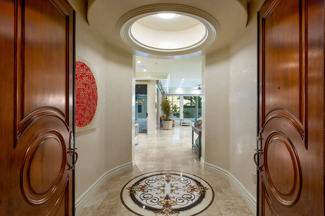 The grand entrance to this One Queensridge Place garden-level high-rise home. (Ivan Sher Group)