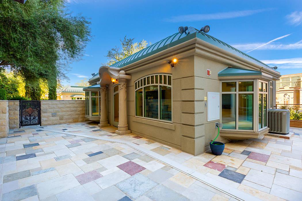 One Queensridge Place garden-level unit 103 has a 1,000-square-foot detached casita. (Ivan She ...