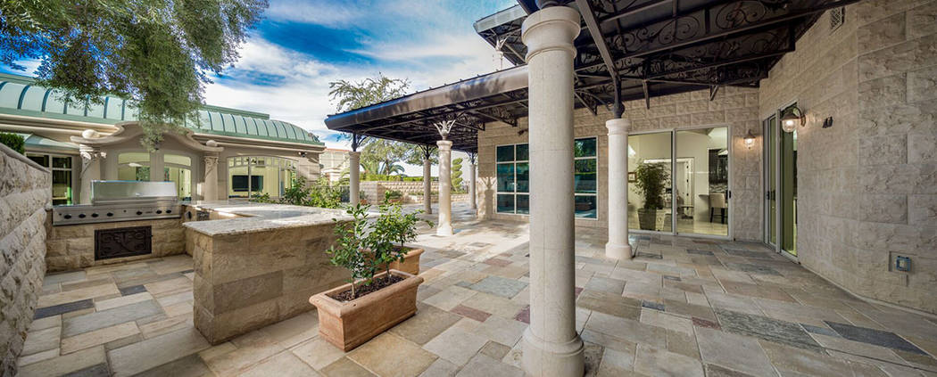 This One Queensridge Place garden-level high-rise home has a 4,000-square-foot courtyard and de ...