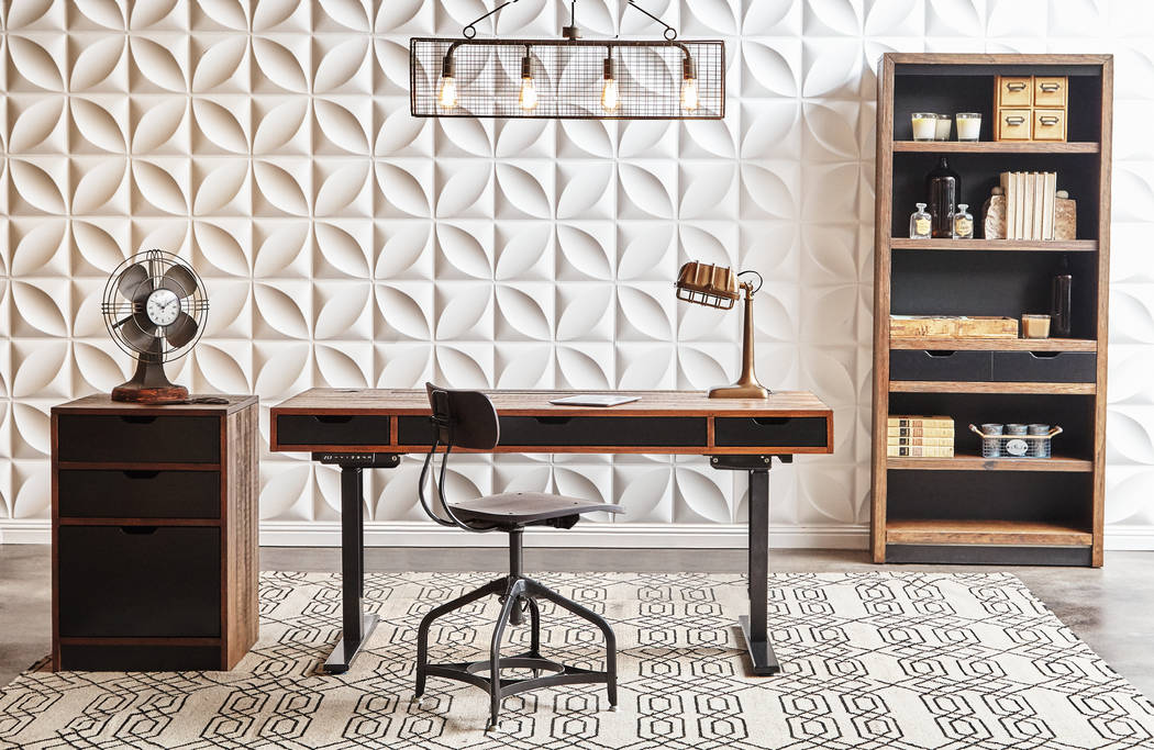 The Motus desk elevates to 46 inches. Three programmable memory settings, two USB outlets and a charging shelf make this functional as much as it is fashionable. (Walker Furniture)