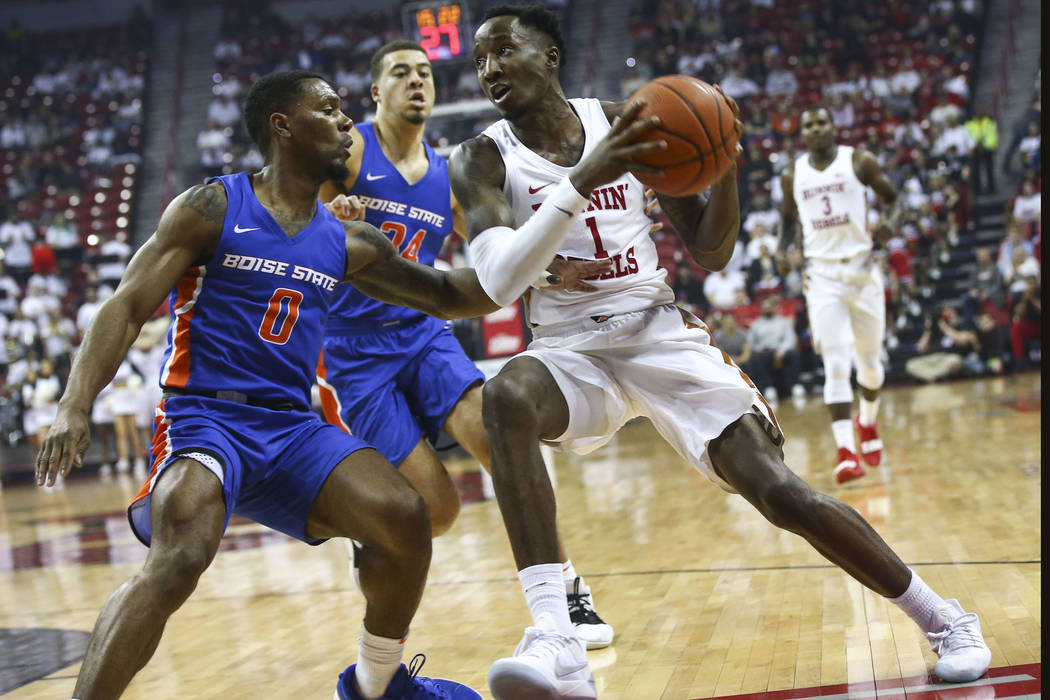 UNLV Rebels guard Kris Clyburn (1) drives to the basket against Boise State Broncos guard Marcus Dickinson (0) during the first half of a basketball game at the Thomas & Mack Center in Las Veg ...