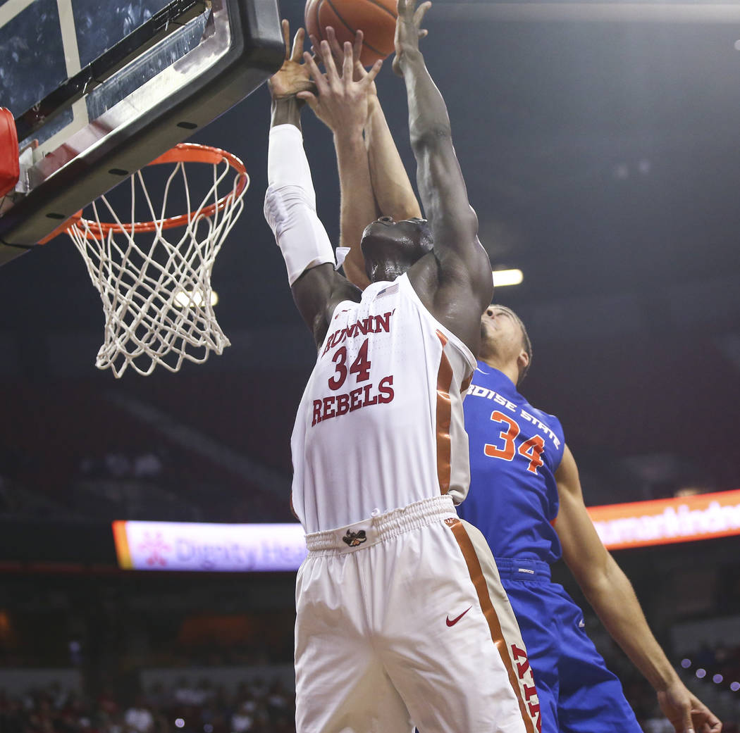 UNLV Rebels forward Cheikh Mbacke Diong, left, and Boise State Broncos guard Alex Hobbs battle for a rebound during the first half of a basketball game at the Thomas & Mack Center in Las Vegas ...