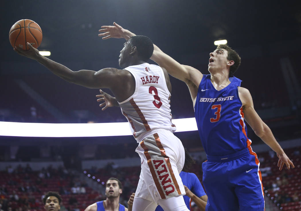 UNLV Rebels guard Amauri Hardy (3) goes to the basket past Boise State Broncos guard Justinian Jessup (3) during the first half of a basketball game at the Thomas & Mack Center in Las Vegas on ...