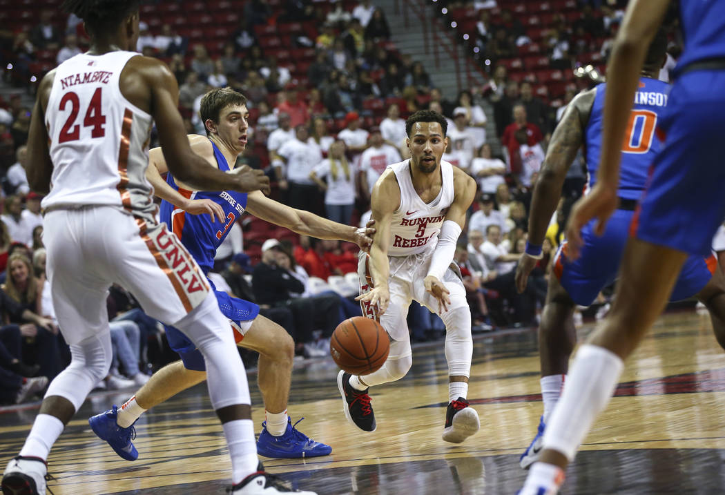 UNLV Rebels guard Noah Robotham (5) passes the ball to forward Joel Ntambwe (24) under pressure from Boise State Broncos guard Justinian Jessup (3) during the first half of a basketball game at th ...