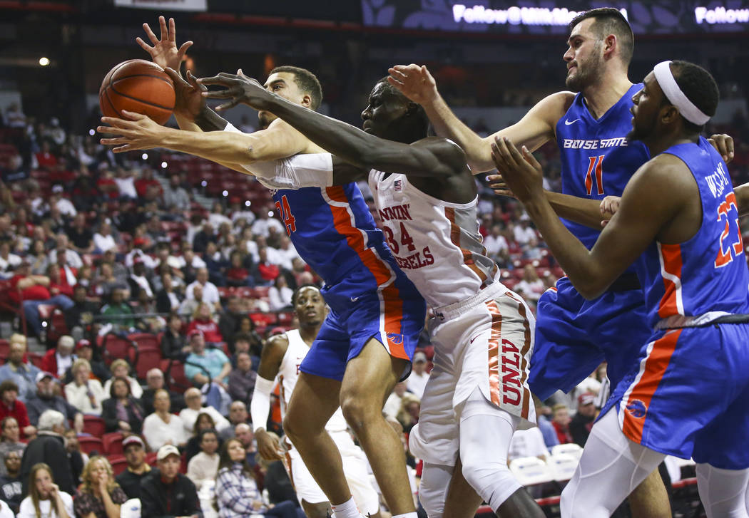 Boise State Broncos guard Alex Hobbs, left, and UNLV Rebels forward Cheikh Mbacke Diong (34) battle for a rebound during the first half of a basketball game at the Thomas & Mack Center in Las ...