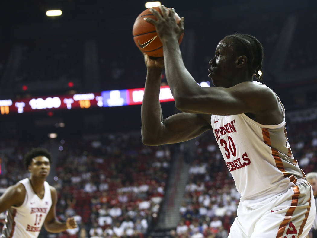UNLV Rebels forward Jonathan Tchamwa Tchatchoua (30) lines up a shot against Boise State during the first half of a basketball game at the Thomas & Mack Center in Las Vegas on Saturday, March ...