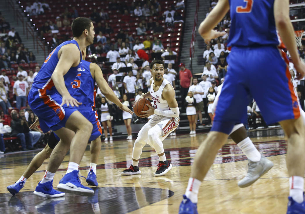 UNLV Rebels guard Noah Robotham (5) brings the ball up court during the first half of a basketball game against Boise State at the Thomas & Mack Center in Las Vegas on Saturday, March 2, 2019. ...