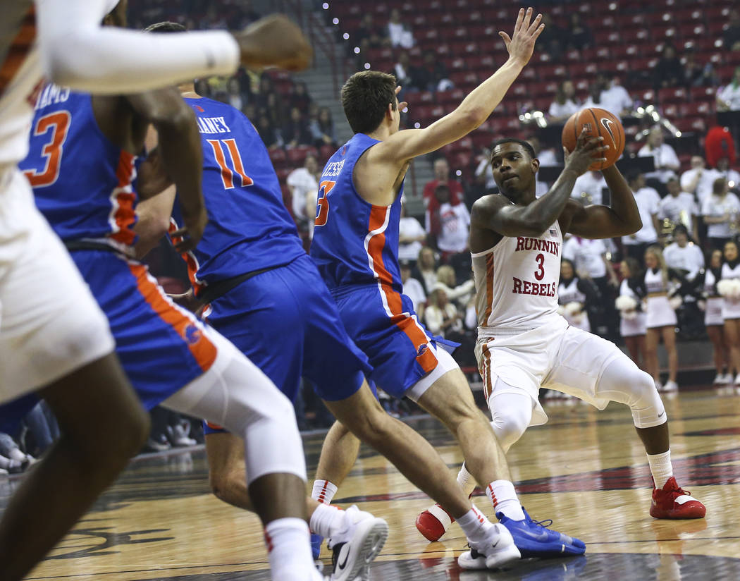 UNLV Rebels guard Amauri Hardy (3) moves the ball around Boise State Broncos guard Justinian Jessup (3) during the first half of a basketball game at the Thomas & Mack Center in Las Vegas on S ...