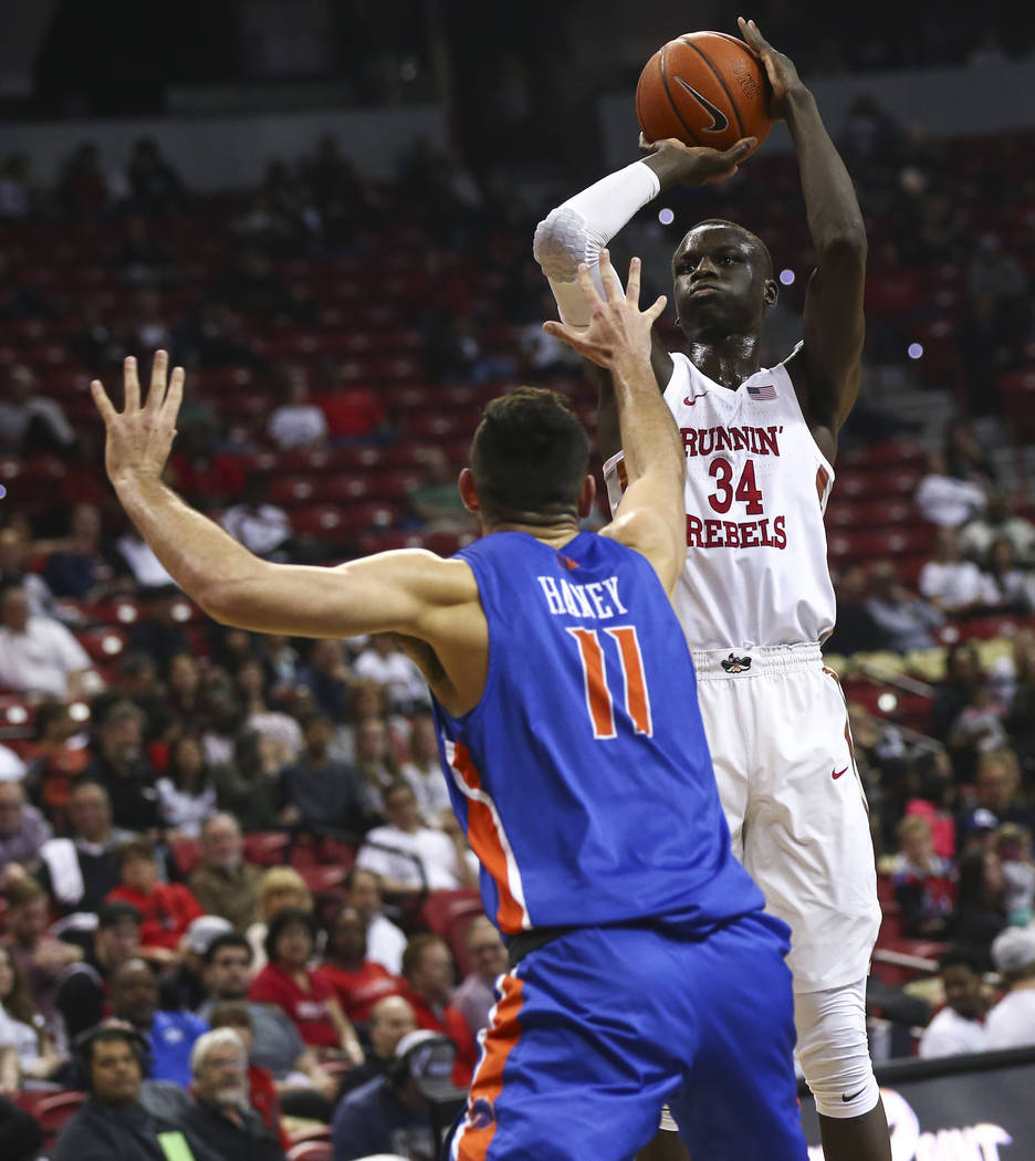 UNLV Rebels forward Cheikh Mbacke Diong (34) shoots over Boise State Broncos guard Zach Haney (11) during the first half of a basketball game at the Thomas & Mack Center in Las Vegas on Saturd ...