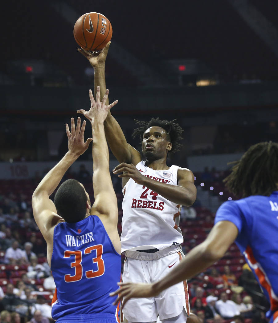 UNLV Rebels forward Joel Ntambwe (24) shoots over Boise State Broncos forward David Wacker (33) during the first half of a basketball game at the Thomas & Mack Center in Las Vegas on Saturday, ...