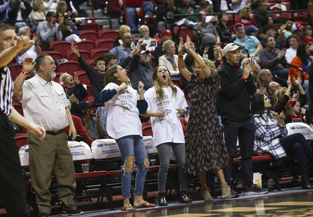 UNLV Rebels fans celebrate a three-point goal during the first half of a basketball game against Boise State at the Thomas & Mack Center in Las Vegas on Saturday, March 2, 2019. (Chase Stevens ...